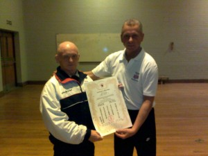 Sensei Bryn Morris being presented with his Godan Certificate by Chief Instructor Sensei Lee